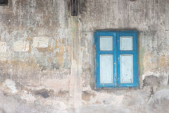 Sky Blue Window on the Old Dirty Wall Stock Photography