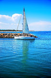 Sailboat sailing in the morning with blue cloudy s. Relaxing in boat,Early morning fishing in the sea royalty free stock photos