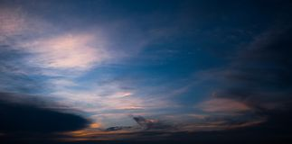 The sky breaks through the yellow clouds. The sky breaks through the clouds stock photography