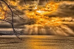 Sky breakthrough over the sea. With dark cloud and orange sun light, very amazing sky in the winter royalty free stock photos