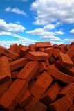 Sky and bricks. Pile of bricks against the cloudy sky background Stock Image