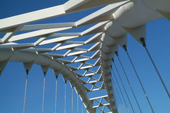 Sky Bridge 1. The arc of a modern suspension bridge stands against a clear blue sky in Toronto, Ontario, Canada stock photography
