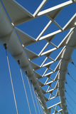 Sky Bridge 2. The arc of a modern suspension bridge stands against a clear blue sky in Toronto, Ontario, Canada royalty free stock photography