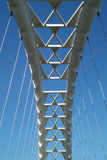 Sky Bridge 4. The arc of a modern suspension bridge stands against a clear blue sky in Toronto, Ontario, Canada royalty free stock photos