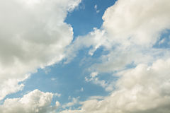 Sky. Bright brown gray clouds with wind on blue light sky Stock Photography