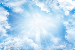 Sky. Bright sun shining in clouds Stock Images