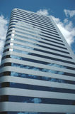 Sky Building. Clouds reflected in the windows of an office building royalty free stock images