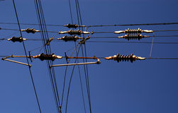 Sky Cables. Electric aerial cables, crossed connectinon, against deep blue sky Stock Images