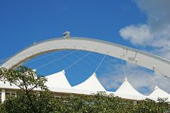 SKY CAR AGAINST THE BLUE SKY ON ARCH OVER MOSES MABHIDA STADIUM. View of architectural detail of Moses Mabhida stadium in Durban Kwazulu Natal against blue sky Stock Image