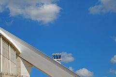 SKY CAR TRAVELING UP THE ARCH OF MOSES MABHIDA STADIUM. View of architectural detail of Moses Mabhida stadium in Durban Kwazulu Natal against blue sky Stock Photos