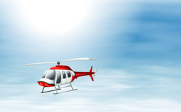 A sky with a chopper flying Stock Photos