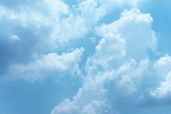 The sky on a clear day. The sky background on a clear day, cloudy, covered with blue and white royalty free stock photo