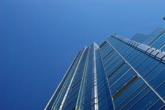 Sky climber. Blue skyscraper glass wall climbing to the sky Stock Photo