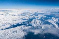 Sky and Cloud from airplane. Sky and clouds seen from the window of an airplane, from above Royalty Free Stock Image
