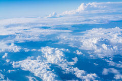 Sky and Cloud from airplane. Sky and clouds seen from the window of an airplane, from above Stock Image