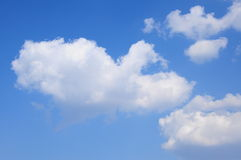 Sky and cloud background. A blue sky and clouds as a background Stock Photos