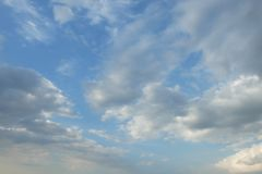 Sky and Cloud. Gray clouds are moving on the clear blue sky Stock Image