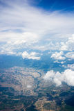 Sky and Cloud. With land aerial shot shot from airplane windows Royalty Free Stock Photo