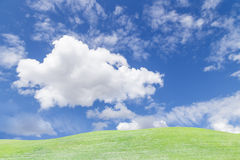 Sky and cloud over green grass hill Stock Images