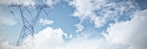 Composite image of sky and cloud on a sunny day. Sky and cloud on a sunny day against the evening electricity pylon silhouette royalty free stock photo