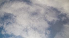 Sky cloud timelapse. White clouds rolling over blue sky in a timelapse video stock video