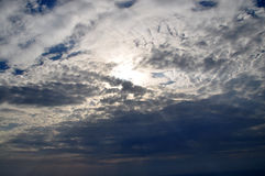 Sky clouds. Cloud blocking sun  in blue sky, sun rays Royalty Free Stock Images