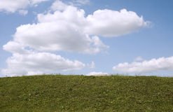The sky in clouds. And a green grass Stock Images