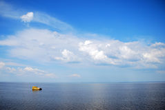 Sky with clouds. Blue sky with clouds, river and downfall Stock Image