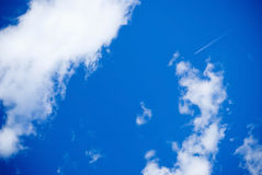 Sky with clouds. Blue sky with clouds and little plane Royalty Free Stock Photography