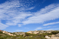 Sky and clouds. White clouds on blue sky to the island of La Maddalena in Sardinia Royalty Free Stock Images