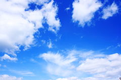 Sky with clouds. A dramatic blue sky with white clouds Stock Photos
