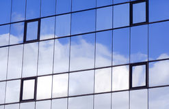 Sky and clouds. Reflected in a modern building glass facade Stock Image