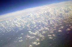 Sky clouds from above. The picture shows fluffy little  blue clouds floating around, the shot was made from an airplane so that it shows the sky from above,it is Royalty Free Stock Photos