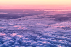 Sky and clouds from above. Clouds and sky as seen through window at sunrise Royalty Free Stock Photos
