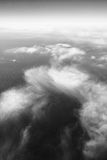 Sky and clouds from above in black and white. Vertical picture of clouds in the sky seen from above Stock Photos