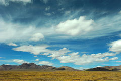 Sky and clouds above the plateau. Sky and clouds above the mountain and field. shot at Tibetan plateau Royalty Free Stock Image