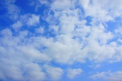 Sky and clouds. Air white clouds against the clear blue sky and Royalty Free Stock Images