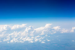 The sky and clouds from the airplane porthole Stock Photos