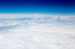 The sky and clouds from the airplane porthole Stock Photography