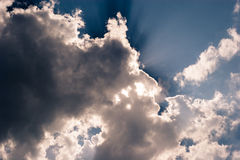 Sky and clouds. Sky background with sunbeams behind clouds Royalty Free Stock Image