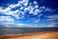 The sky with clouds and a beach. Royalty Free Stock Photo