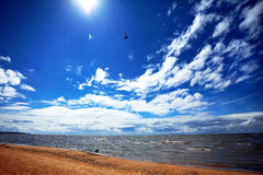 The sky with clouds and a beach. Stock Images