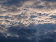 The sky with clouds: on the blue, the atmospheric rows are heavy white cumulus clouds. Sky with clouds: on the blue, the atmospheric rows are heavy white Stock Image