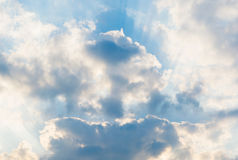 Sky and clouds. Blue sky with clouds and sun reflection Royalty Free Stock Photography