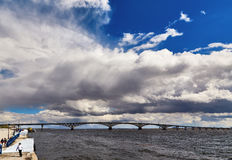 Sky with clouds, Bridge through Volga, fragment of the embankment Stock Images