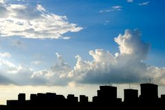 Sky, clouds and building silhouette Stock Photos