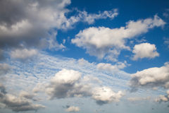 Sky with clouds. Clean blue and white clouds. The background and texture Royalty Free Stock Images
