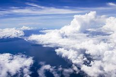 Sky, clouds, earth and ocean. Aerial shot of the sky, clouds, earth and the ocean stock image