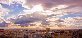 Sky, clouds, either. Estepona city, Andalusia, Spain. Sunny day at the beach Stock Image