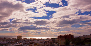 Sky, clouds, either. Estepona city, Andalusia, Spain. Sunny day at the beach Stock Images